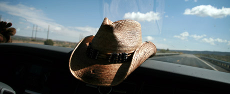 Louis' hat on the dashboard as we drive out of Tuba City