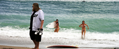 Louis and female surfers at the beach in Jupiter