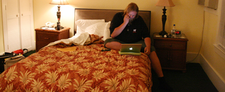 Louis checking his e-mail from the bed we were about to share