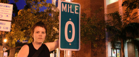 Selma posing with the Mile 0 marker on 490 Whitehead Street